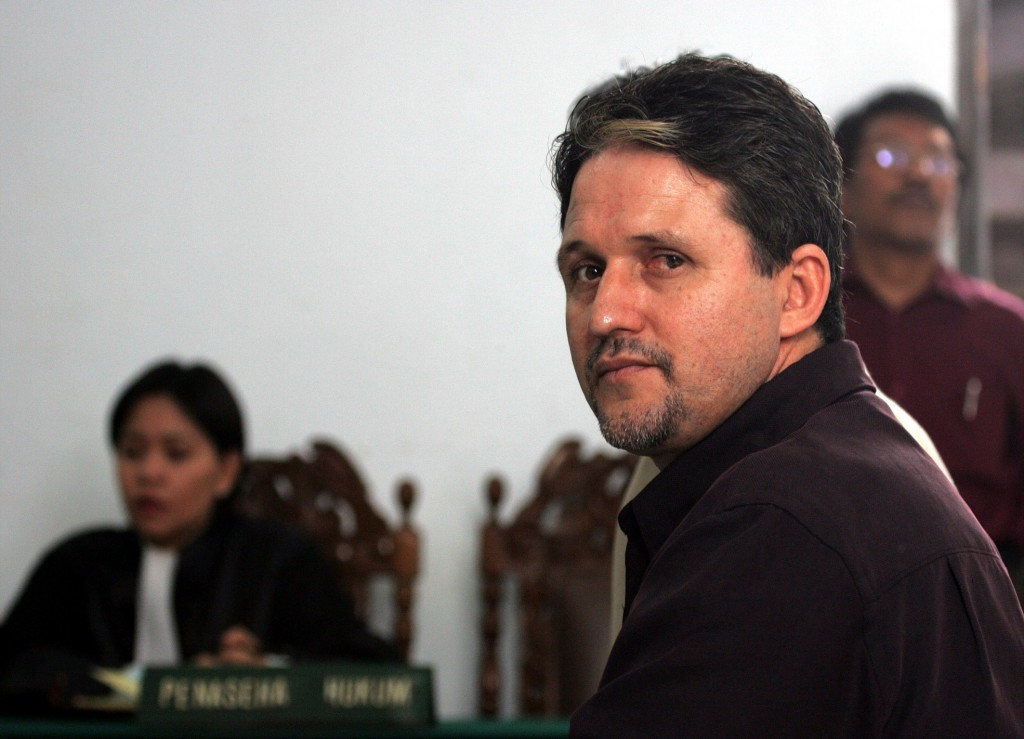 File picture shows Brazilian citizen Marco Archer Cardoso Moreira sitting in front of his lawyer at Tangerang court, near Jakarta